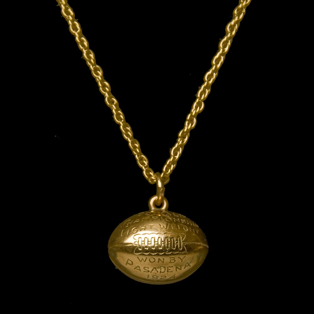 Gold necklace with football charm