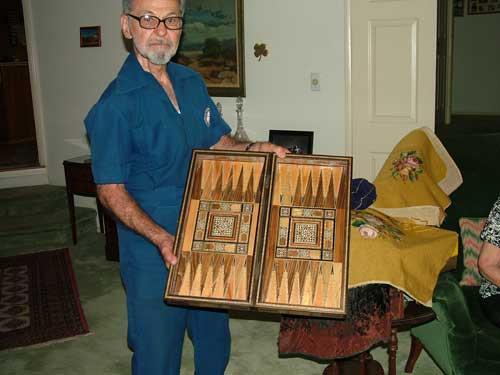Sooren Kalousdian holding a tavloo board game open