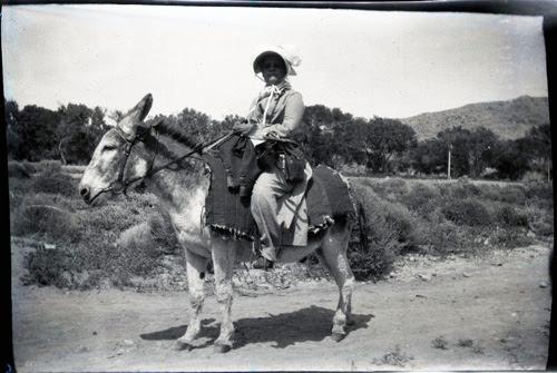 Eva Fenyes riding a burro
