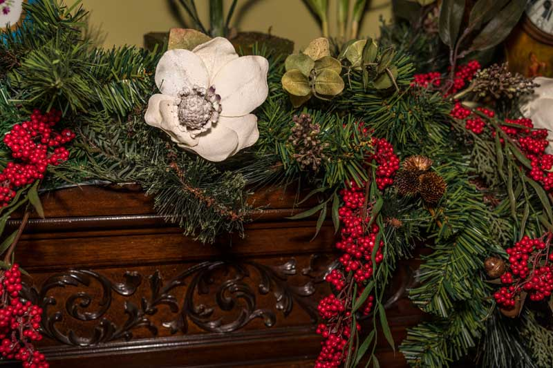evergreen on fireplace mantle